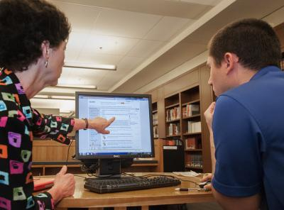 Librarian for Sociology and Cultural Anthropology Linda Daniel consults with a student in Perkins Library
