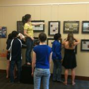 Students installing exhibit