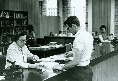 Photo of librarian helping a student